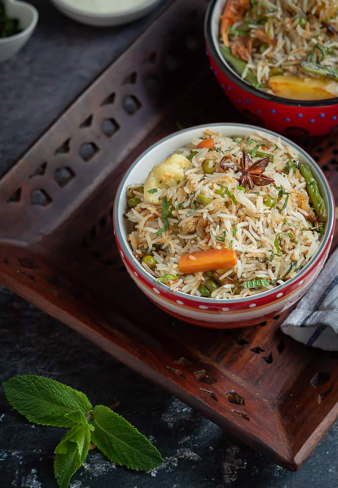 Veg pulao top down shot in a wooden tray.