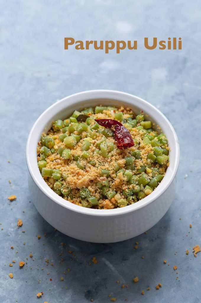 Beans paruppu usili - displayed on a white bowl in a top down shot.