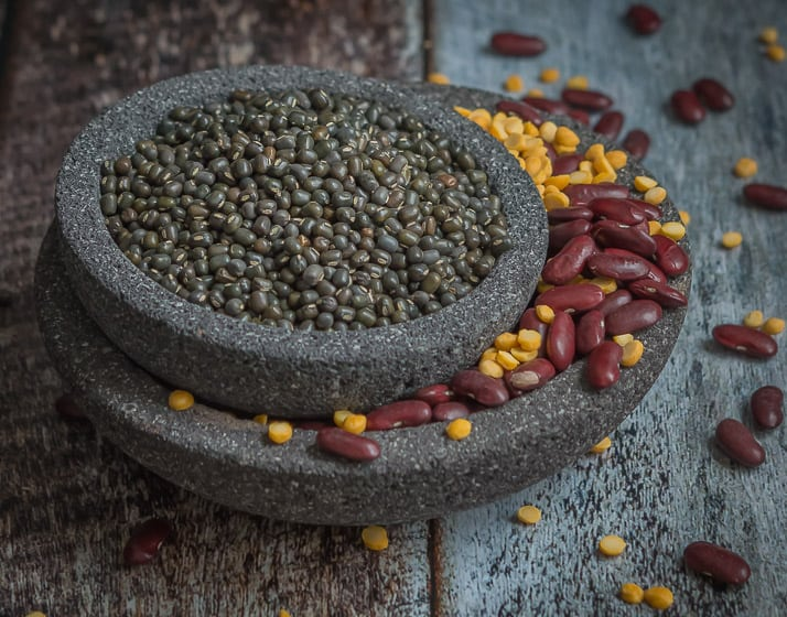 mimxture of urad dal, channa dal & rajma in a rustic background on a stoneware
