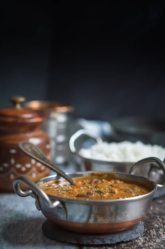 Dal Makhani in a traditional Indian serving dish along with rice.