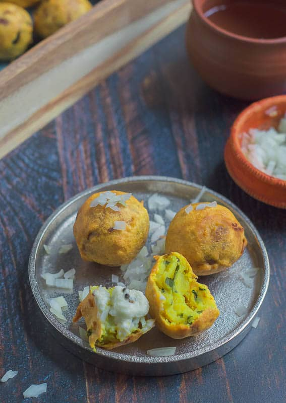Aloo Bonda - A deep fried snacks made with potato stuffing and chickpea flour coating.