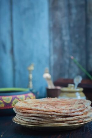 Ellu Thengai Poli using wheat flour - A sweet flatbread made with whole wheat flour and filled with jaggery, coconut and sesame seeds.