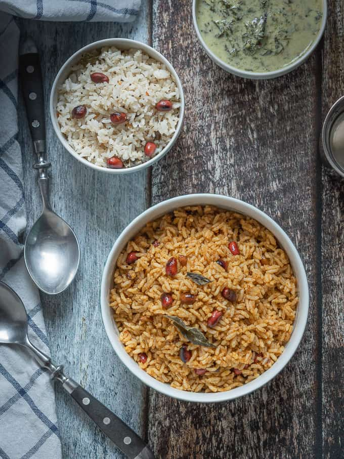 Puliyodharai, rice mixed with pulikachal | Tamarind rice displayed on a bowl in top down shot.