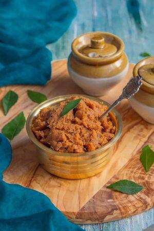 ginger chutney served in a brassware.