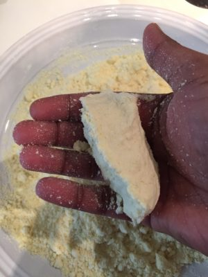 process shot describing the consistency of rice flour for making vella puttu
