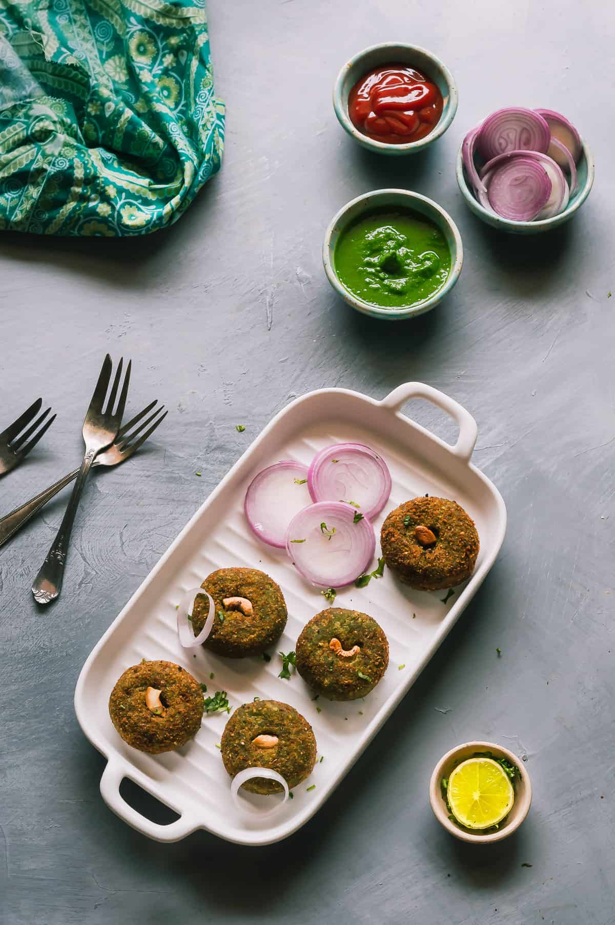 Hara bhara kabab are soft patties made with pureed spinach and peas. Serve them as appetisers or as an evening snack along with hot piping chai or tea.