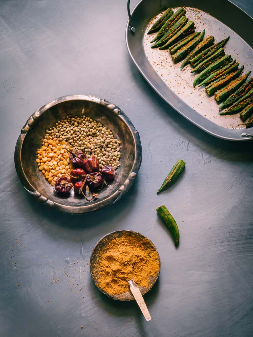 Prep shot of stuffed okra with spice mix made from dry red chillies, lentils and coriander seeds and peanuts (optional).